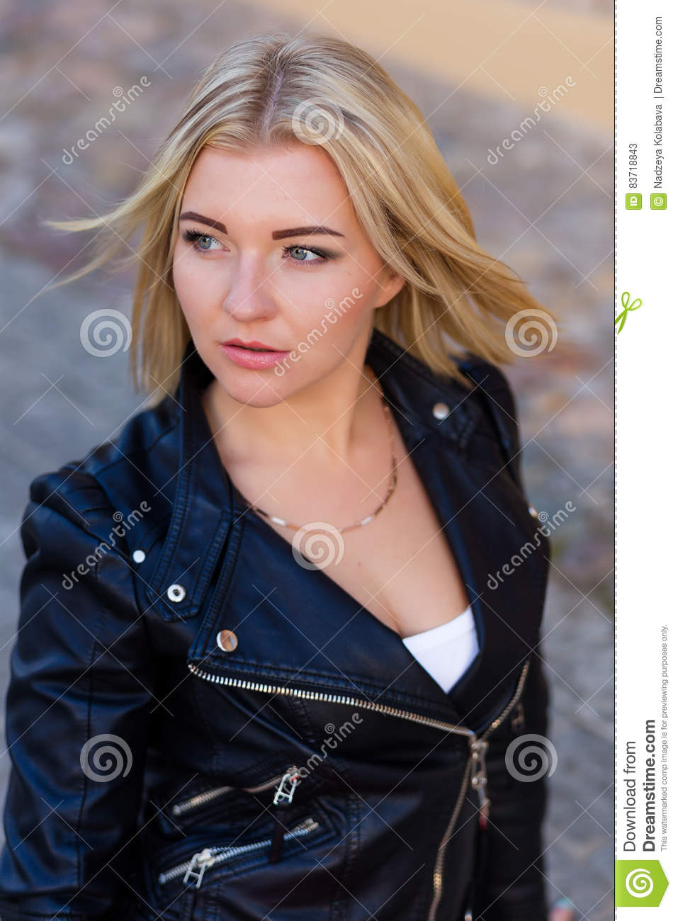 Portrait Of A Beautiful Blonde Outdoors In Summer Stock Photo