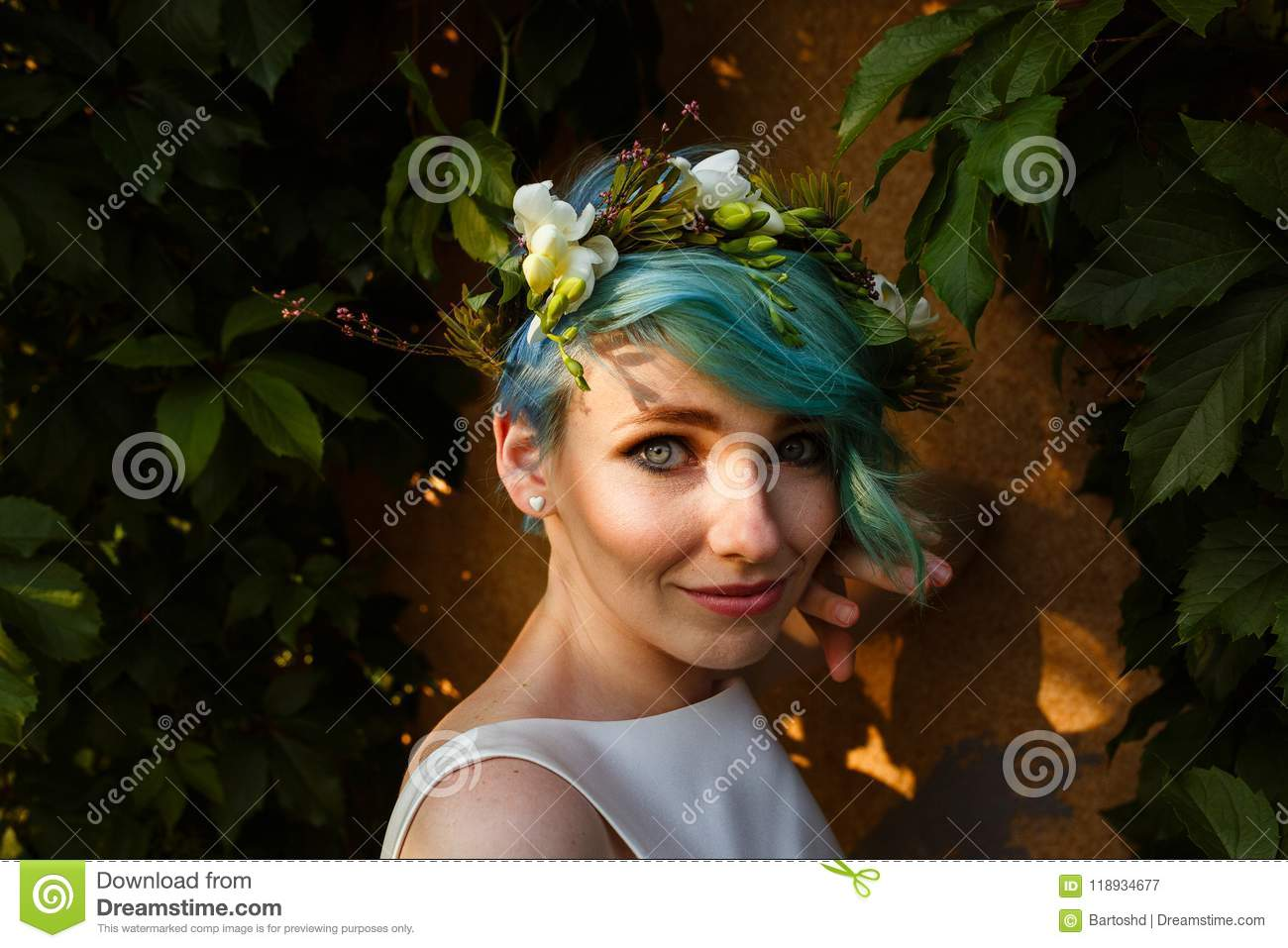 Portrait of a beautiful bride with blue hair and a wreath of real portrait of a beautiful bride with blue hair and a wreath of real flowers wedding day a beautiful bride portrait in the forest izmirmasajfo