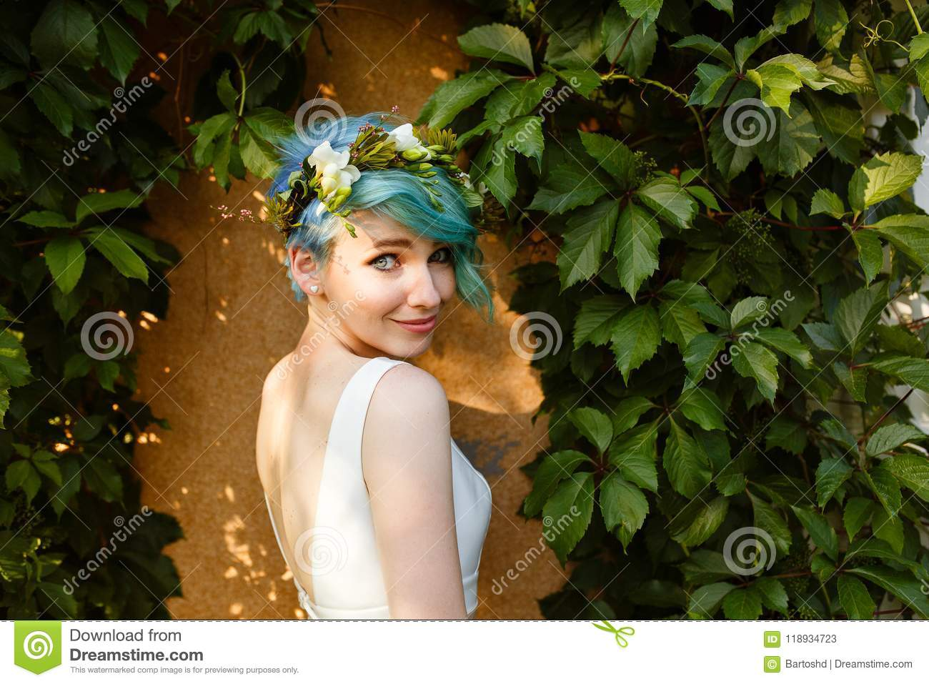 Portrait of a beautiful bride with blue hair and a wreath of real portrait of a beautiful bride with blue hair and a wreath of real flowers wedding day izmirmasajfo