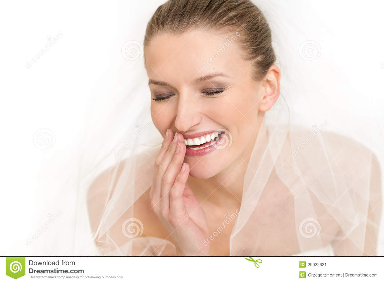 Portrait of beautiful bride wedding dress and veil she is smiling and