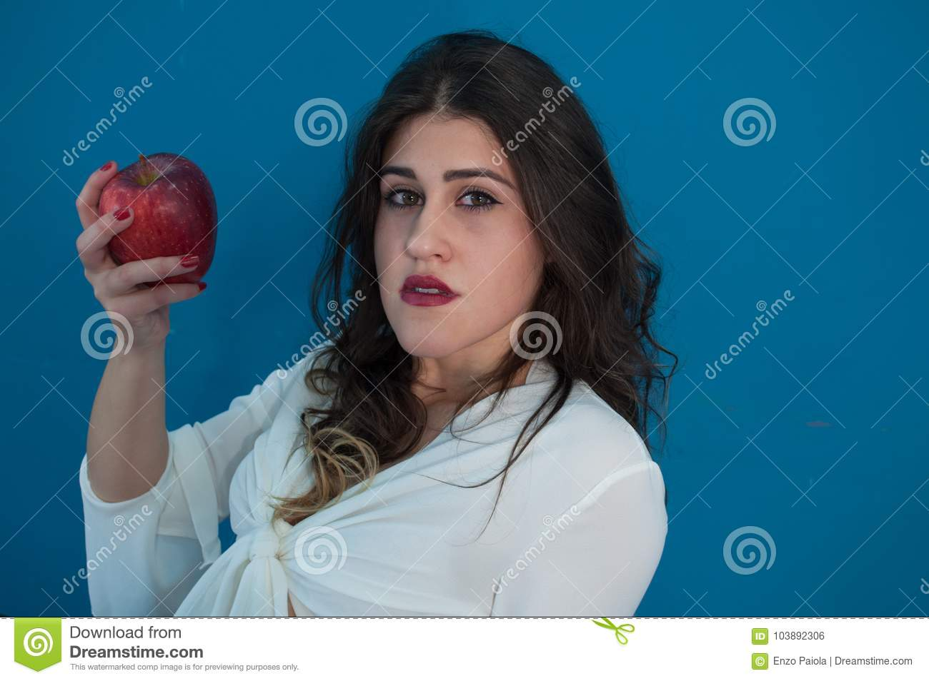 Studio photo with cute girl and apple