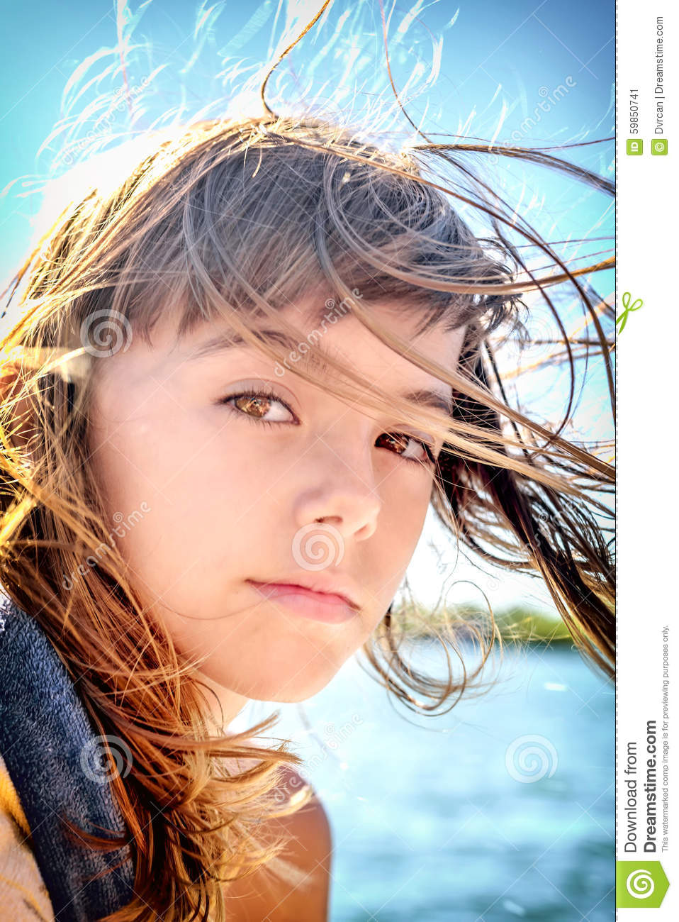 Portrait Of A Beautiful Eight Year Old Girl With The Wind