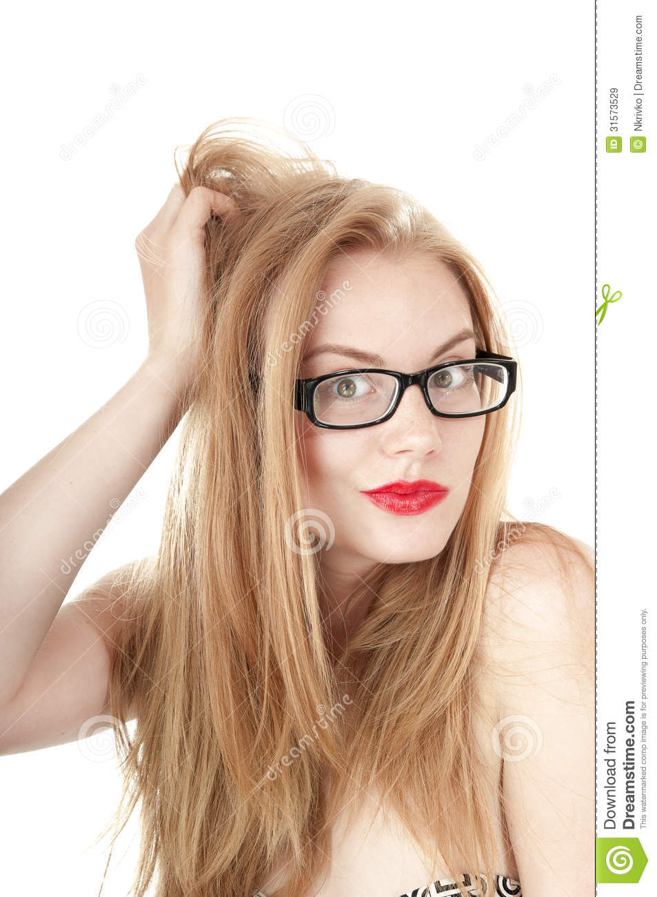 Portrait of beautiful embarrassed girl in glasses.
