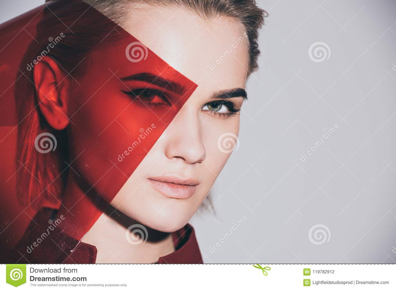 Portrait of beautiful fashionable girl posing with red filter