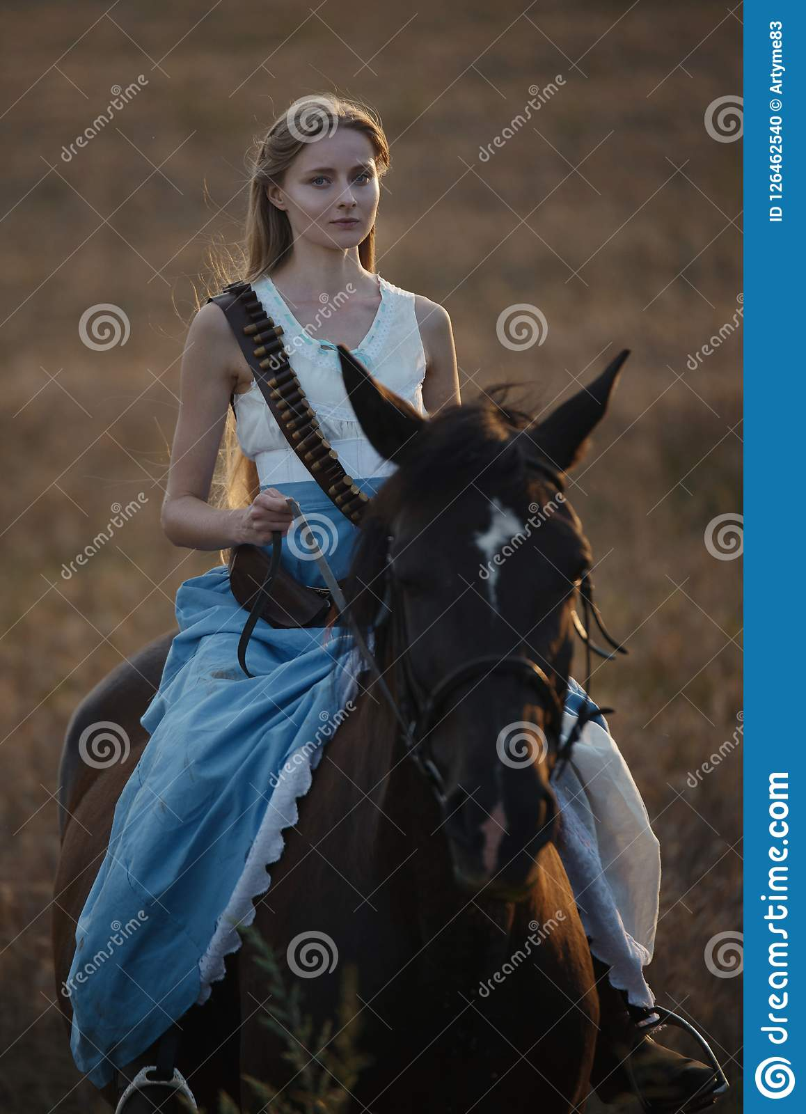 Portrait Of A Beautiful Female Cowgirl With Shotgun From Wild West Riding A Horse In The Outback Stock Photo Image Of Grass Hair 126462540