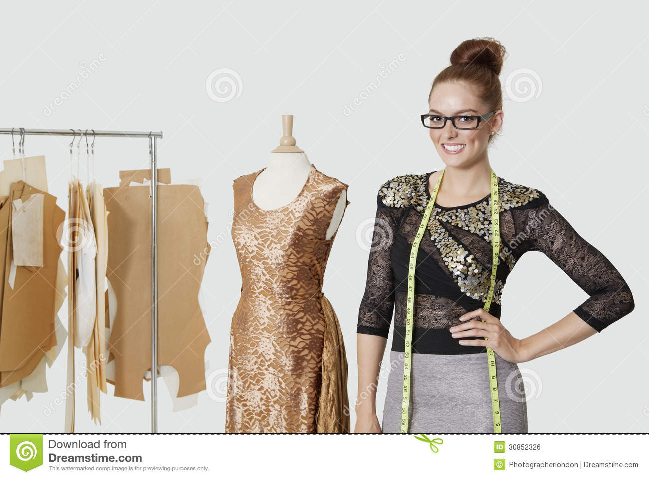 Portrait of beautiful female fashion designer standing for To be a fashion designer