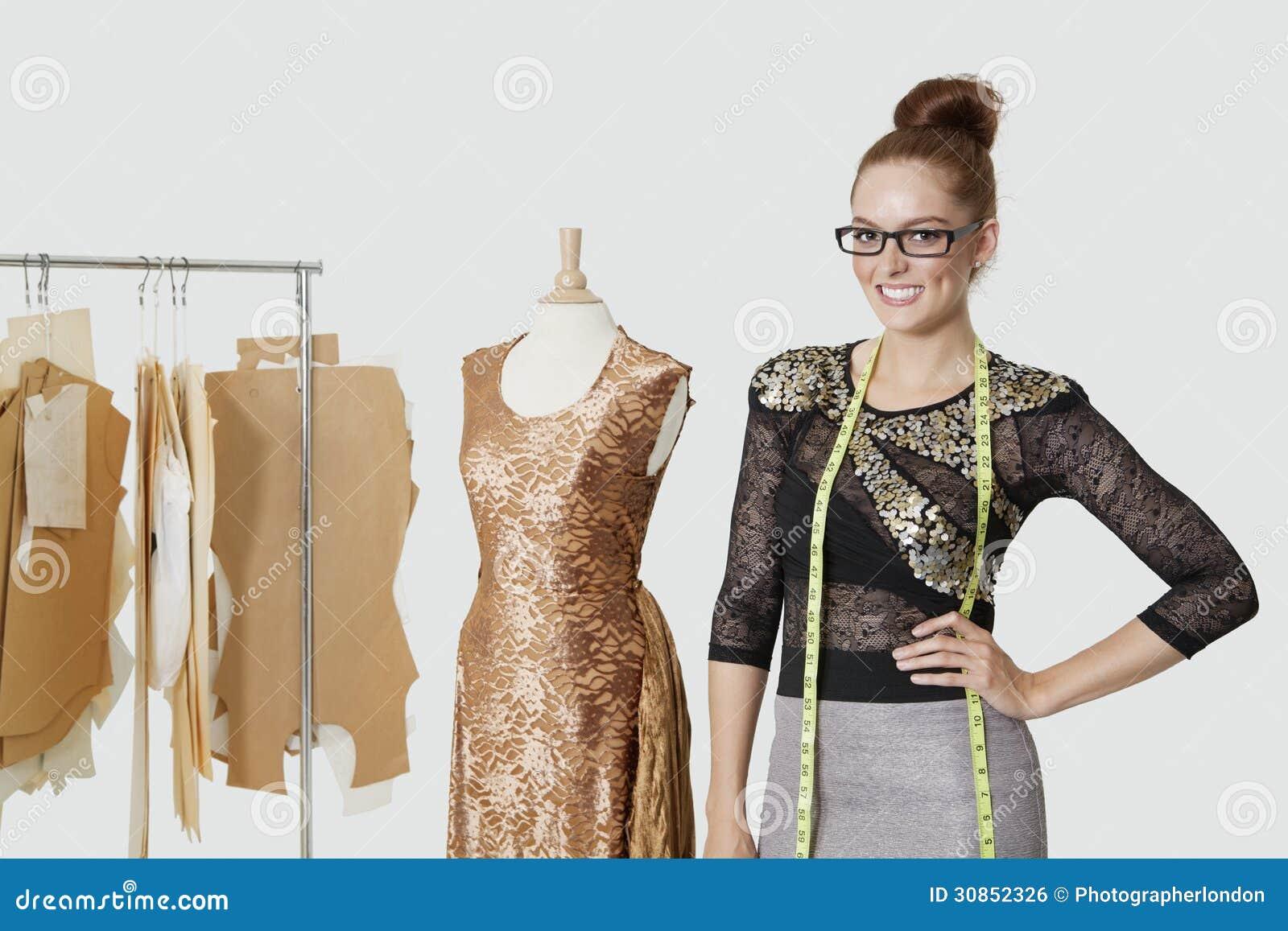 Portrait Of Beautiful Female Fashion Designer Standing ...