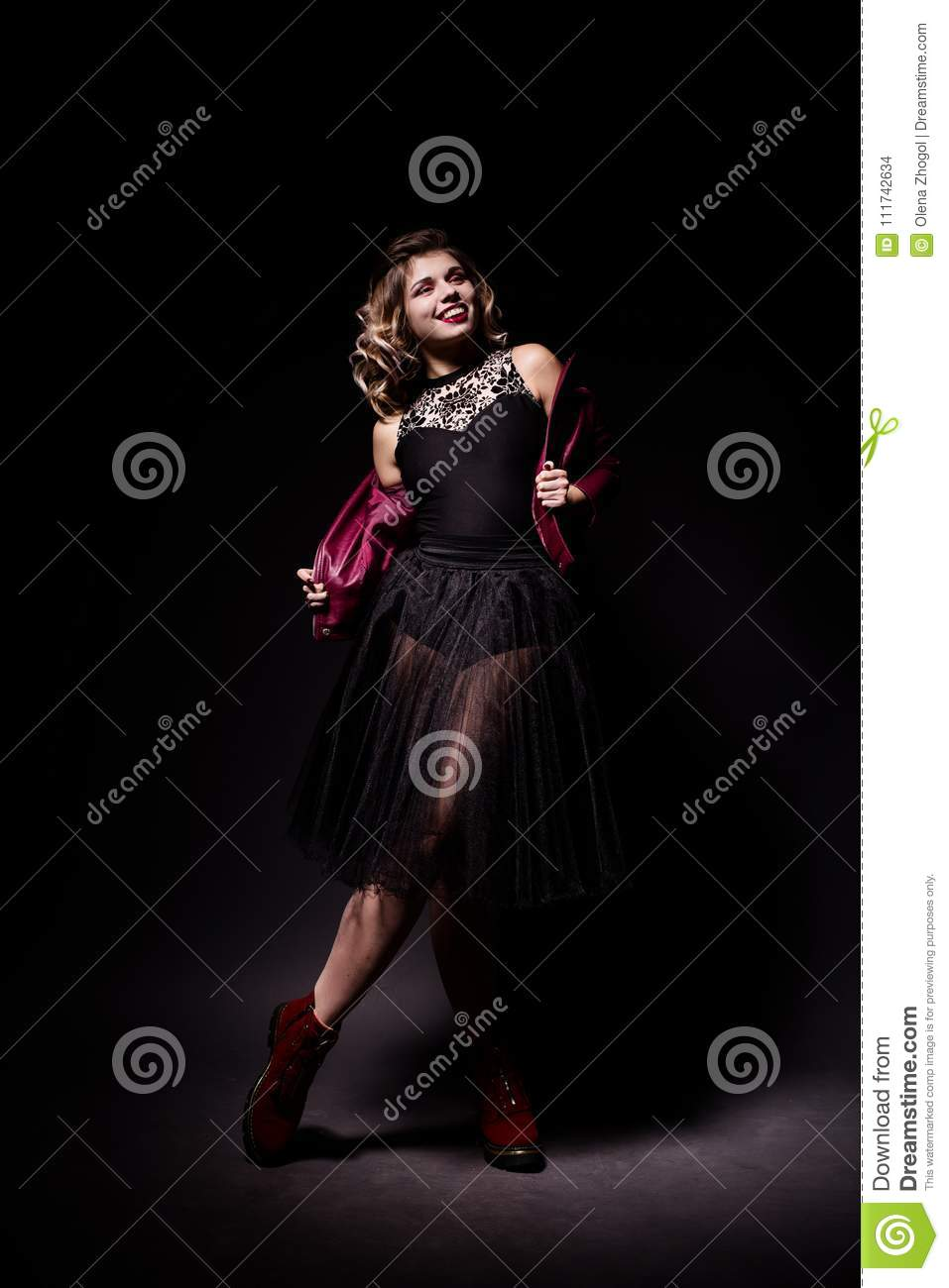 Portrait of beautiful fit young ballerina girl in black casual and ballet clothes