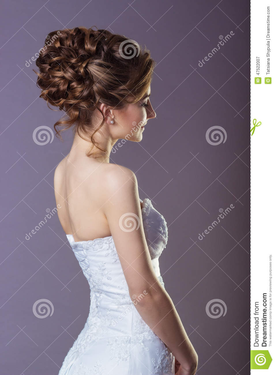 Portrait of a beautiful gentle and elegant girl women bride in a white dress with a beautiful hairstyle and makeup