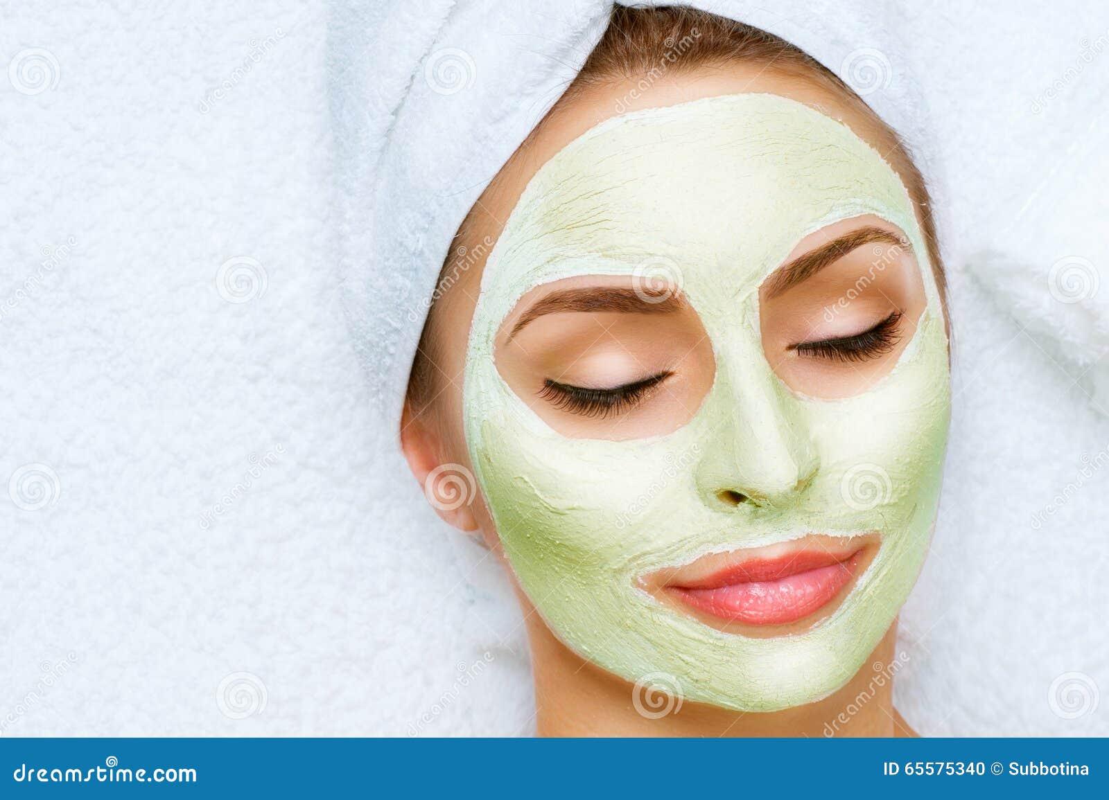 Apply facial mask hot woman