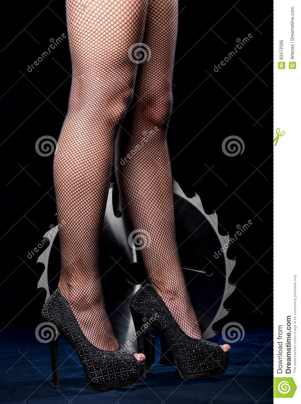 Portrait of beautiful girl with circular saw blade. Bretty woman legs, mesh stockings, black heeled shoes, sawblade
