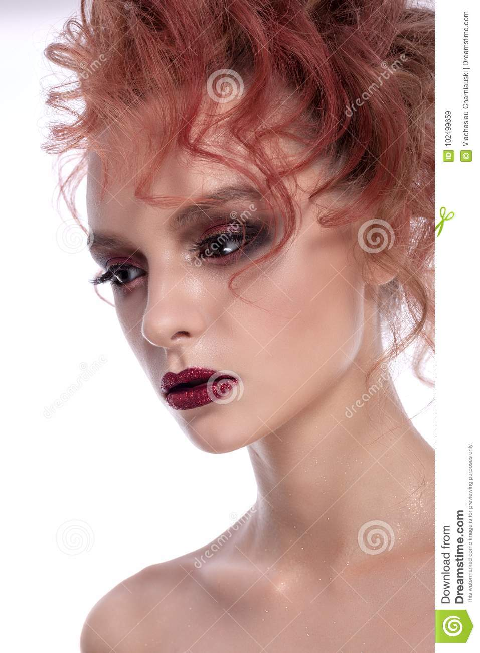 Portrait of a beautiful girl with a creative hairstyle and makeup.