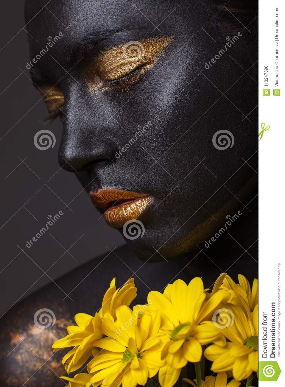 Portrait of a beautiful girl with a creative make-up, close-up.