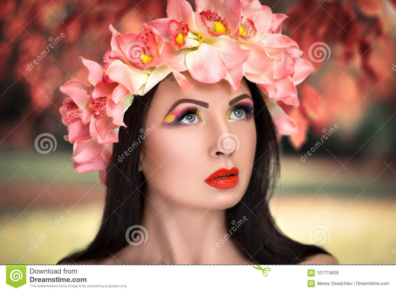 Beautiful Girl in a Flower Wreath
