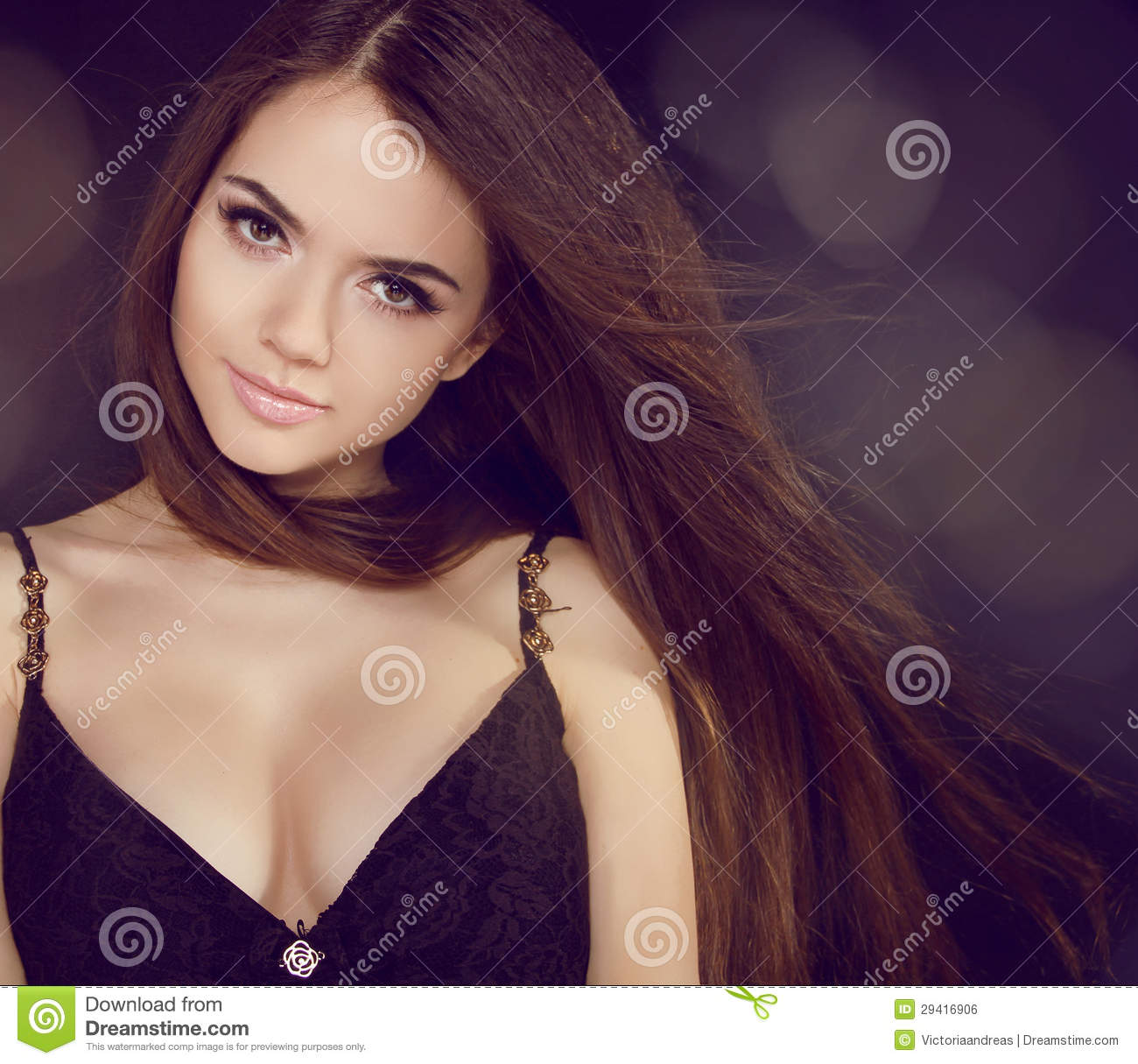 Portrait of a beautiful girl with flying brown hair