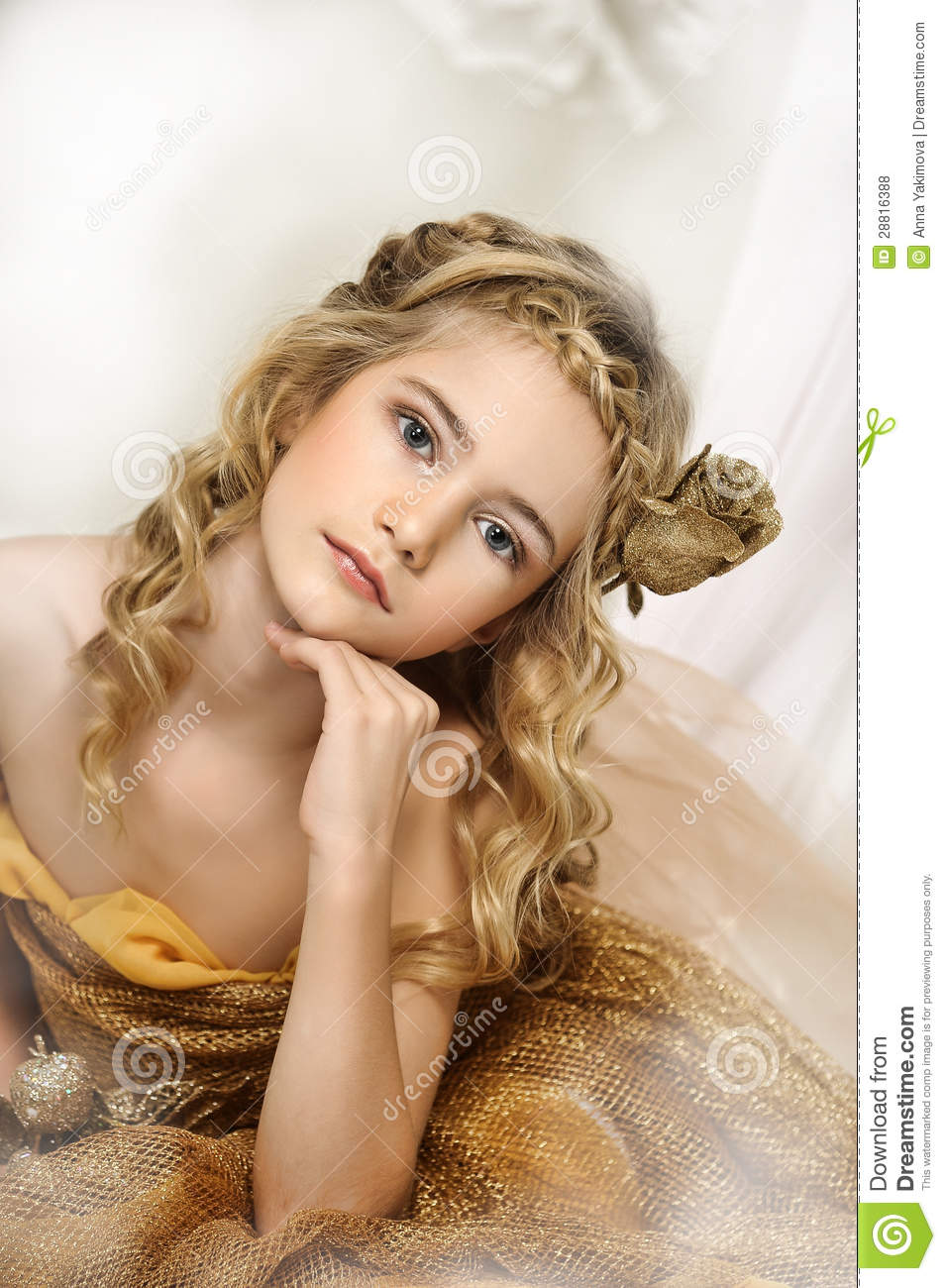 A Beautiful African: Portrait Of A Beautiful Girl In A Gold Stock Photo