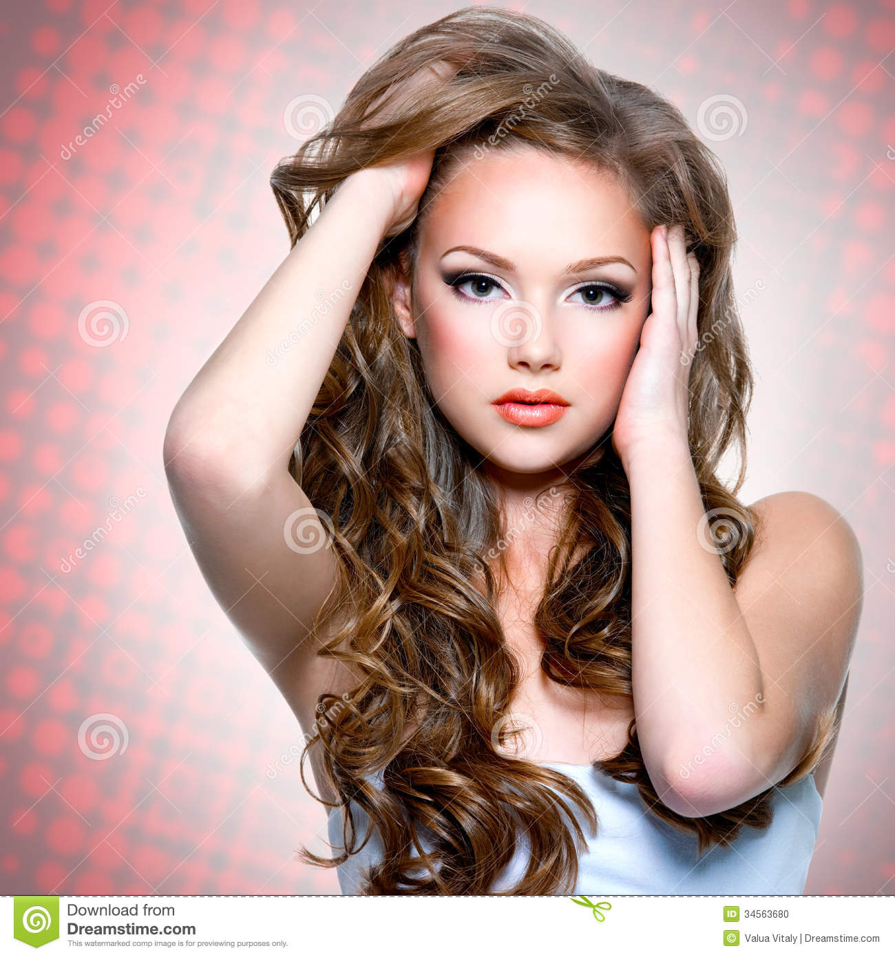 Portrait Of The Beautiful Girl With Long Curly Hairs Stock