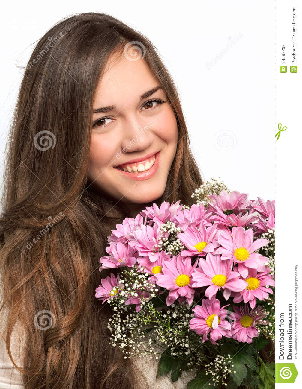 Portrait of a beautiful girl with long hair and a pink flowers