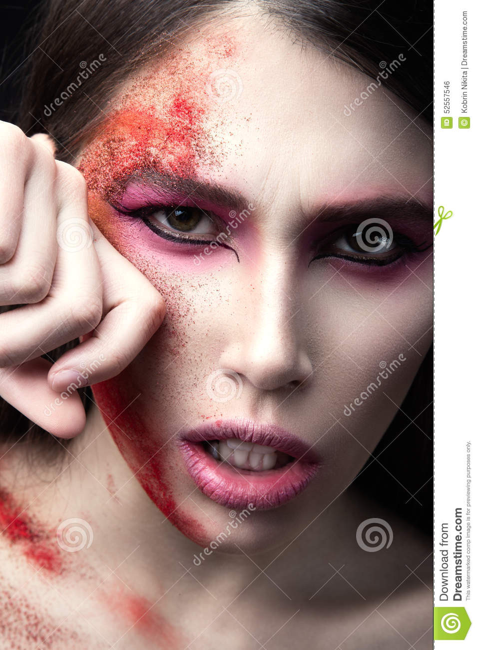 Portrait Of A Beautiful Girl With Red Paint On Her Face. Art ...