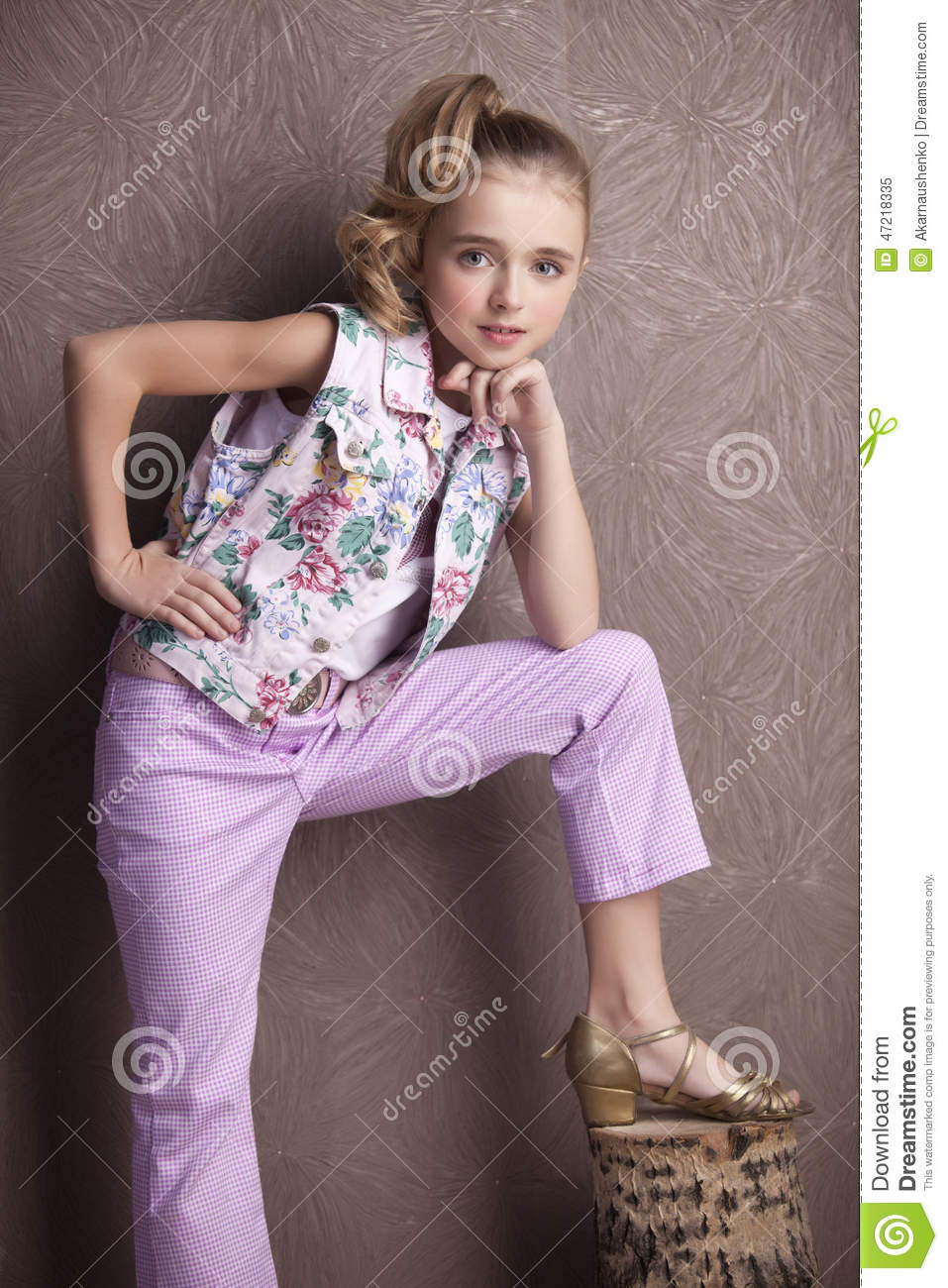 Portrait Of A Beautiful Girl In T Shirt And Trousers Stock