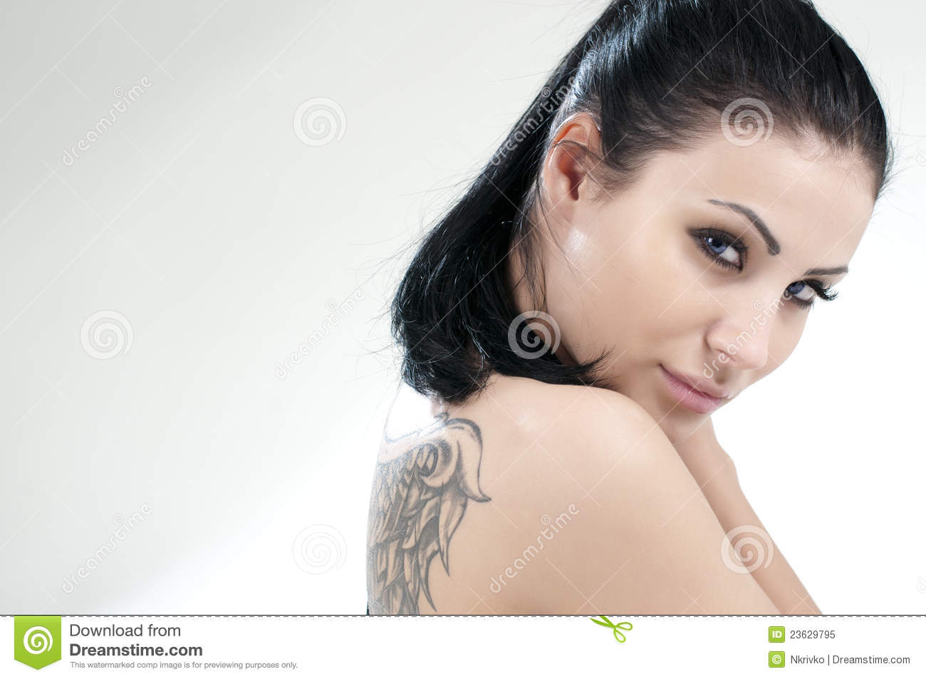 Portrait of beautiful girl with tattoo