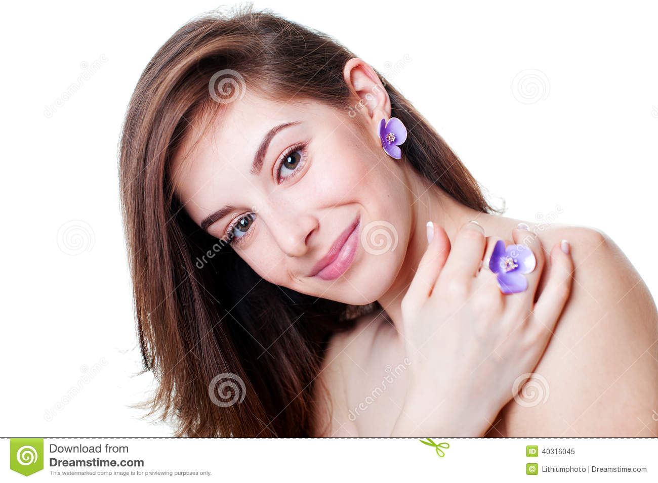 Portrait of beautiful girl with violet flower bijouterie