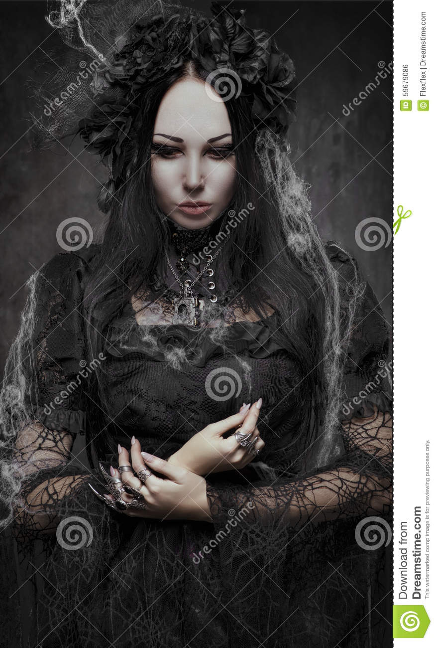Portrait of beautiful Gothic woman in dark dress