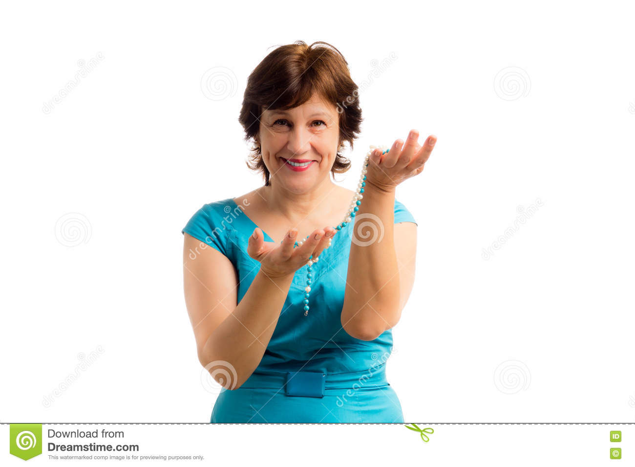 portrait of beautiful happy mature woman wigh bead string in hands