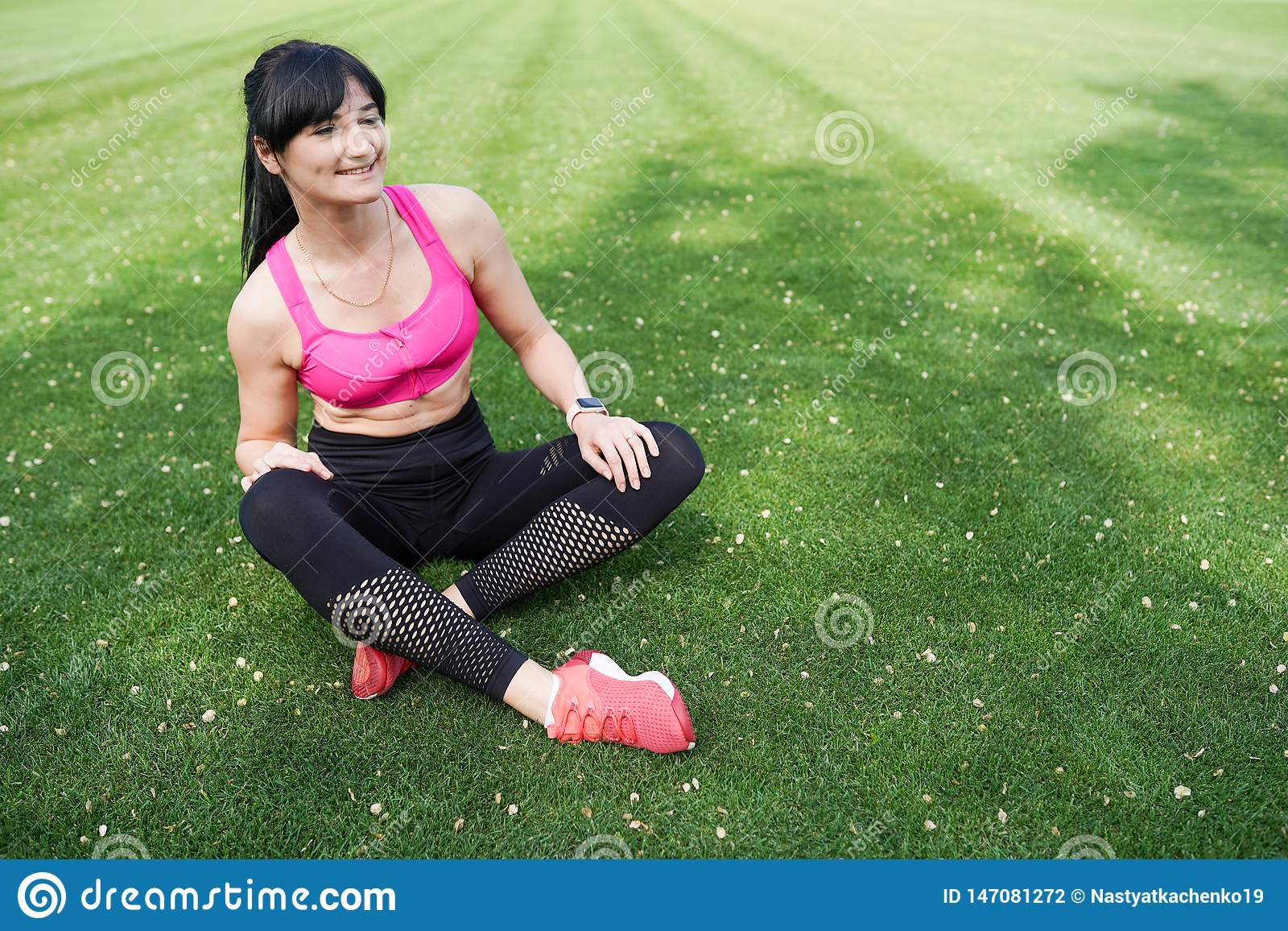 Portrait of a beautiful and healthy sport girl on green background