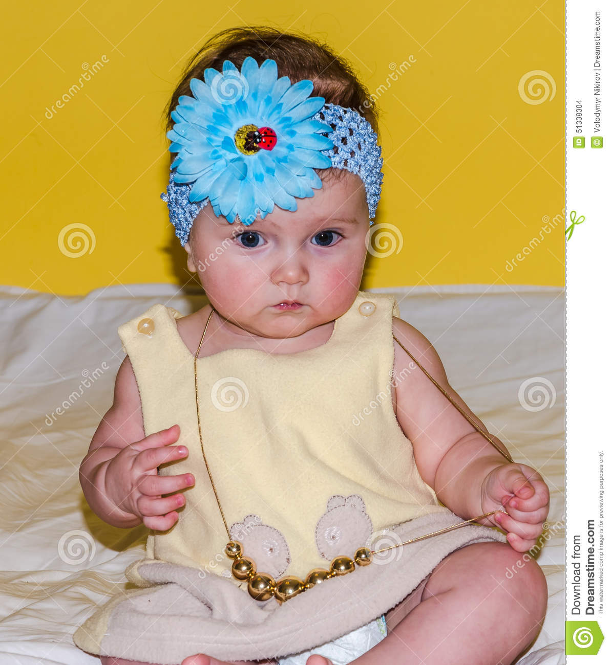 135dab1f8a41 Portrait Of A Beautiful Little Baby Girl In A Yellow Dress With A ...