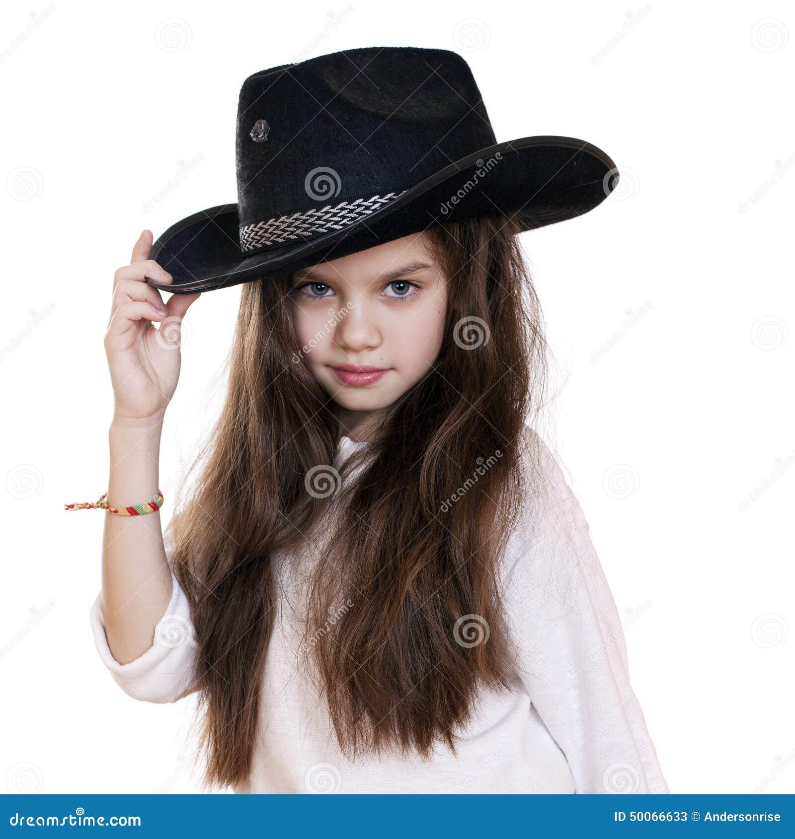 Portrait Of A Beautiful Little Girl In A Black Cowboy Hat Stock ... ff0ba22aa9b