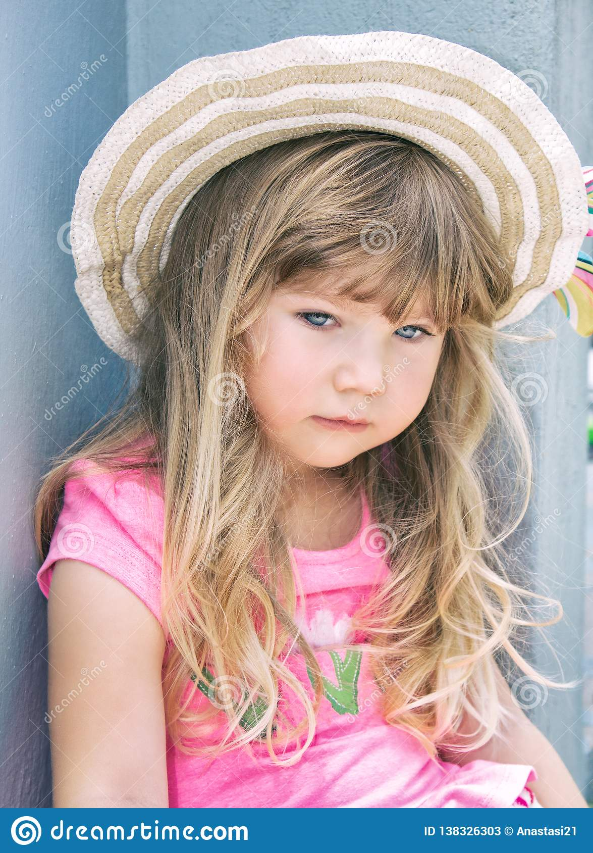 Portrait of a beautiful little girl in a hat