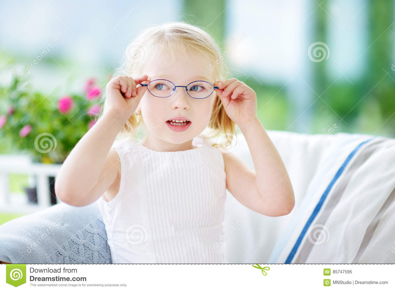 cd179a6058e Portrait Of Beautiful Little Girl Wearing Glasses At Home Stock ...