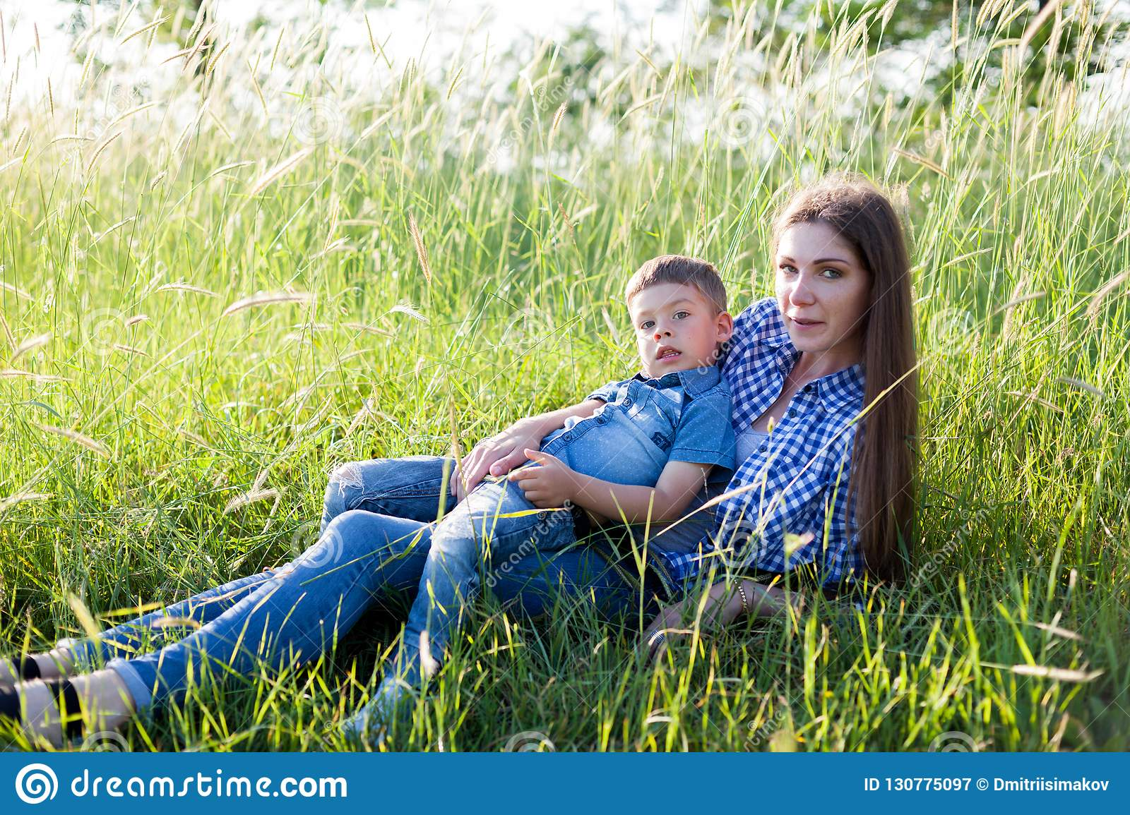 Portrait of a beautiful mother with a young son outdoors travel