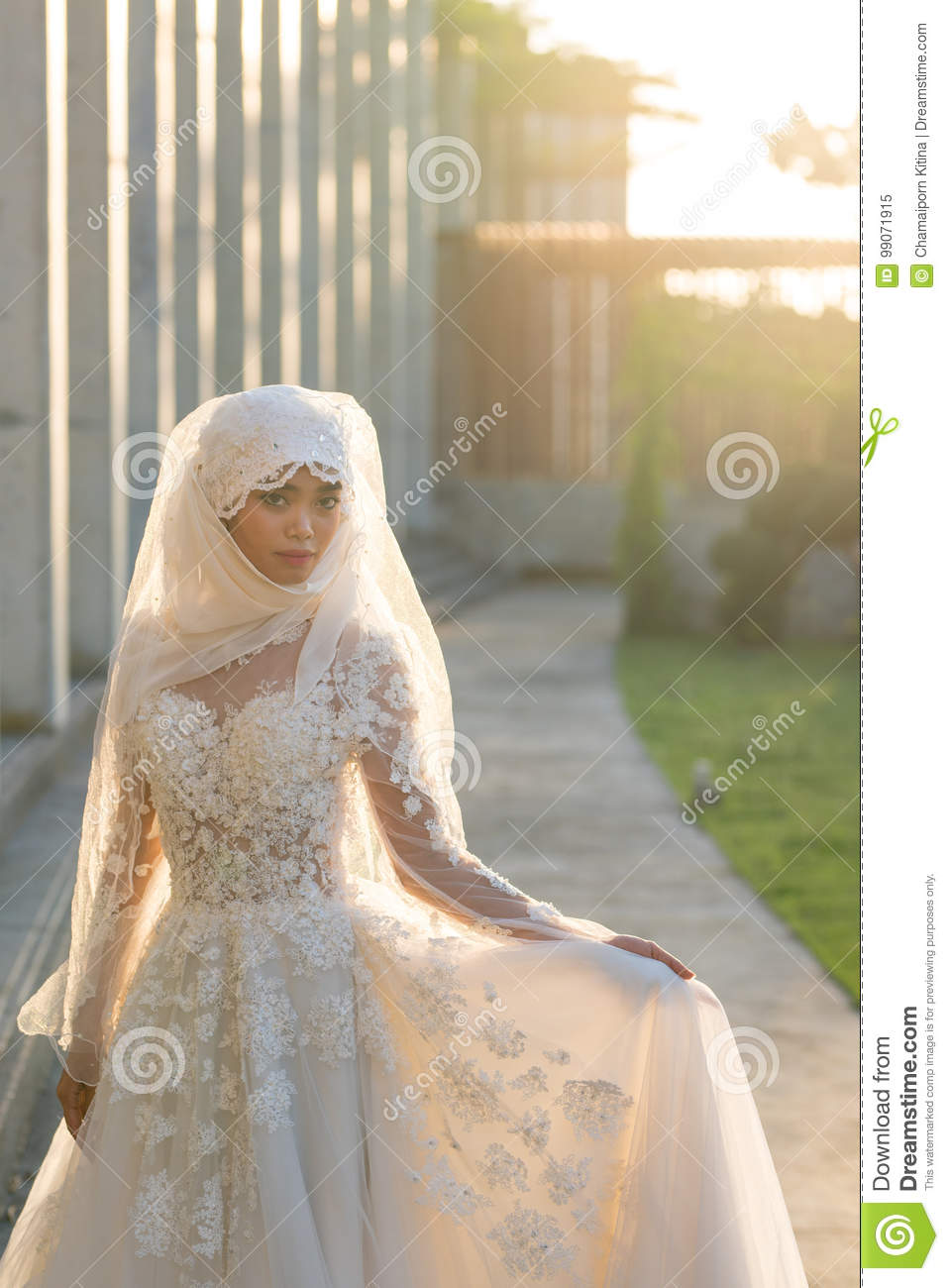 Portrait Of A Beautiful Muslim Bride With Make Up In White Weddi ...