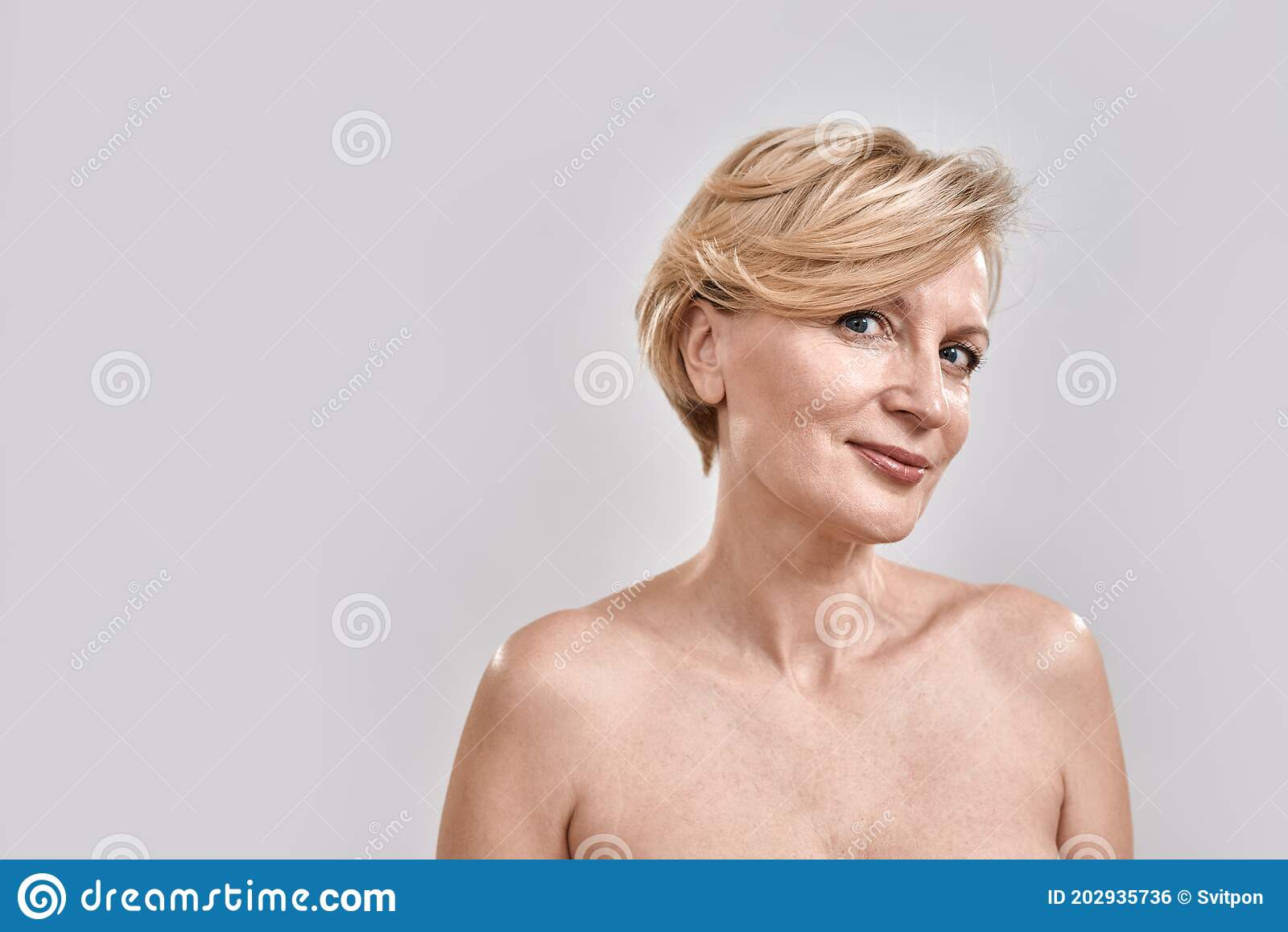 Full length nude woman holding blank banner Stock photo
