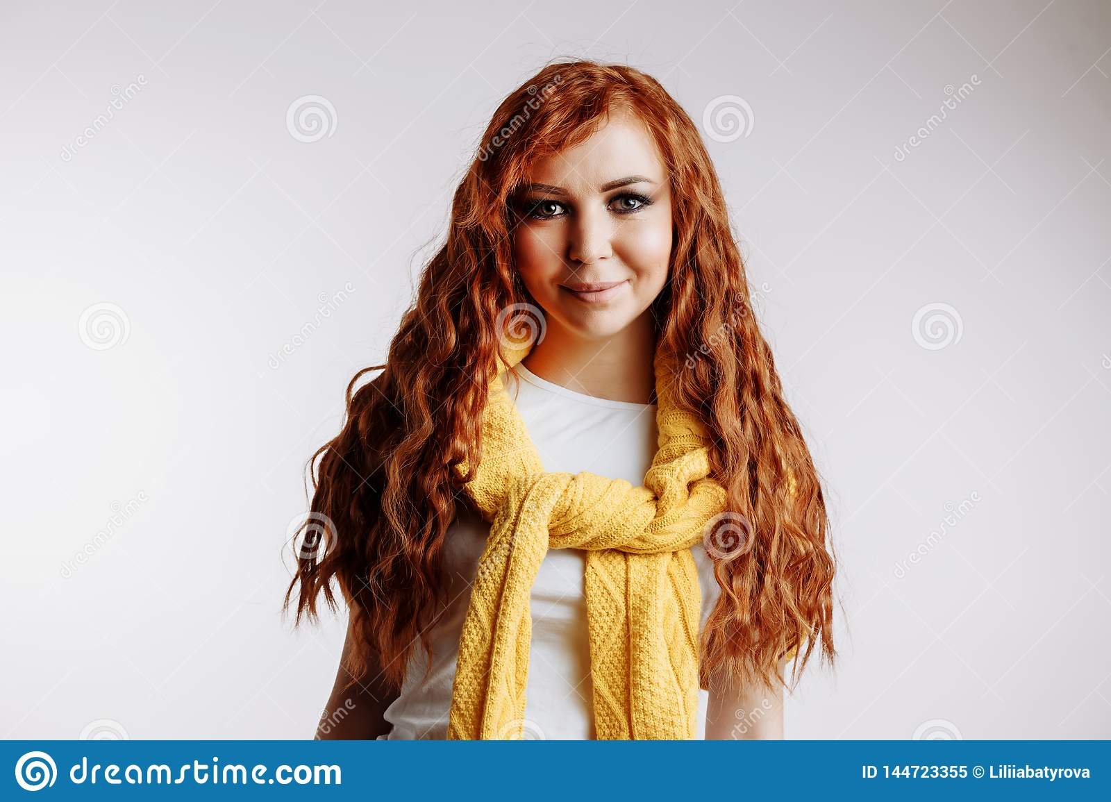 Portrait of beautiful redhead girl with long hair