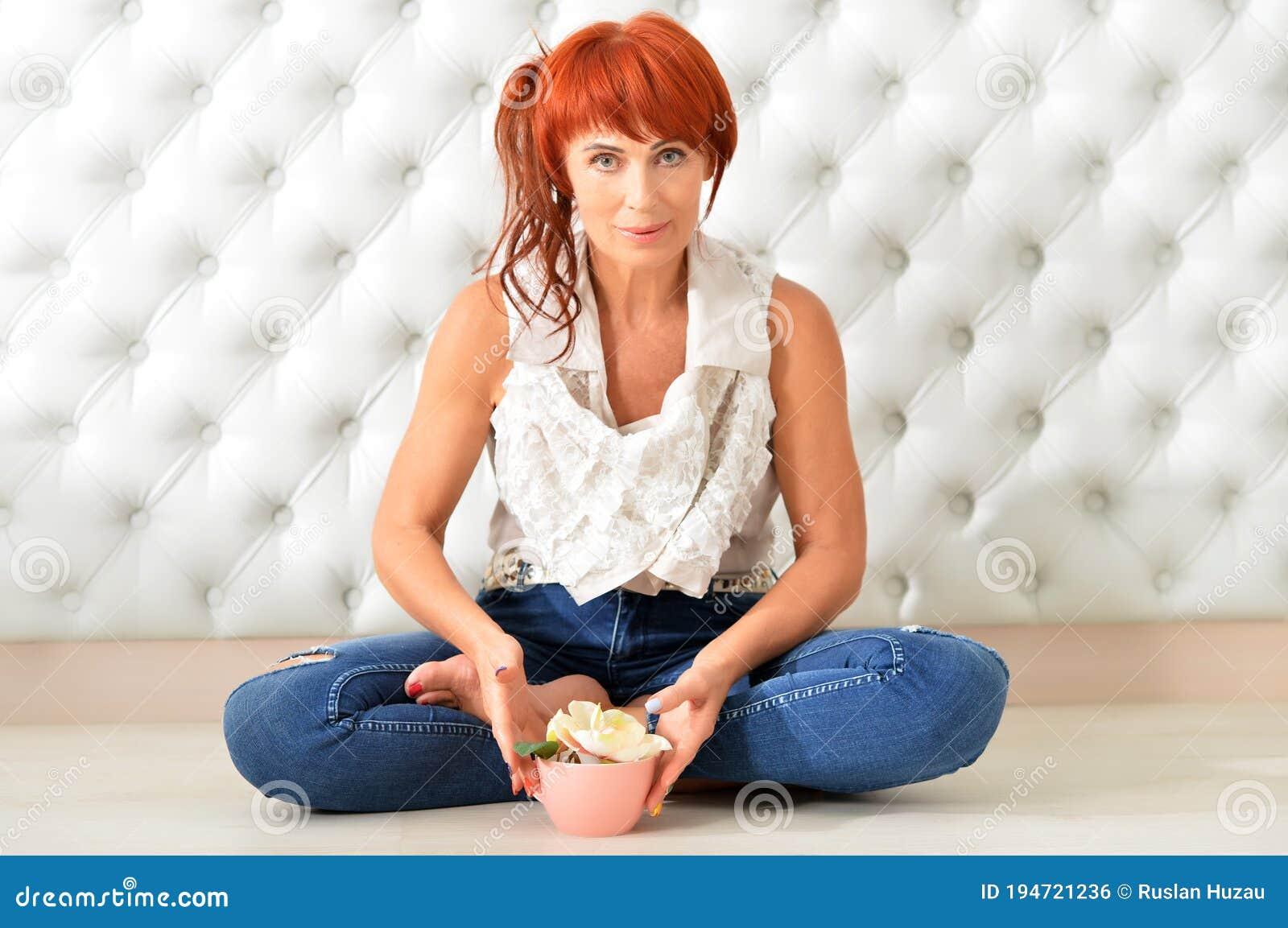 Smiling Redhead Woman Posing Stock Photo - Download Image