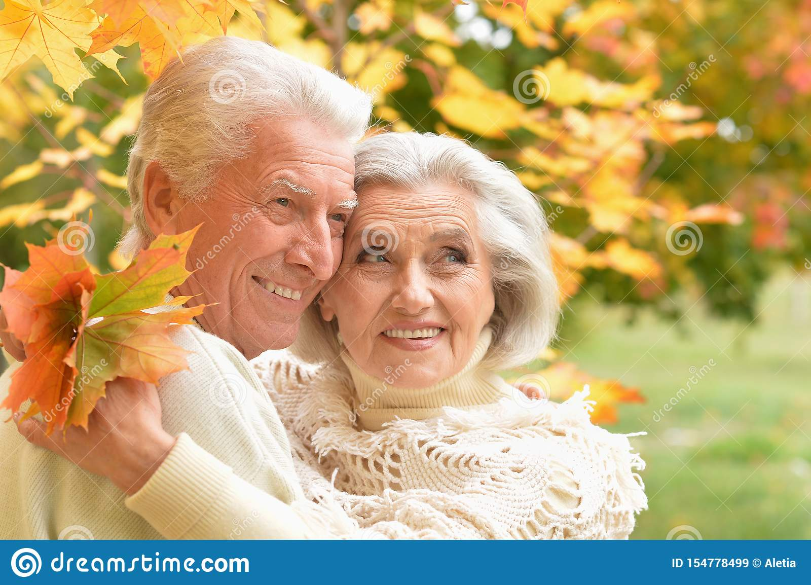 Portrait of beautiful senior couple relaxing in the park