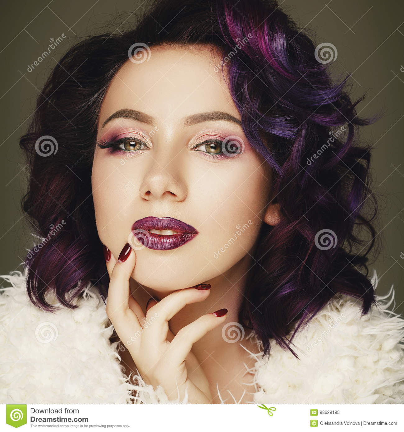 Portrait of beautiful fashion model with purple hair over g