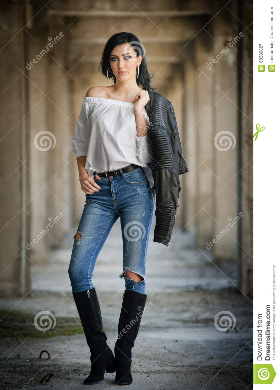 8220a0b6ce8 Portrait Of Beautiful Young Woman With Modern Outfit