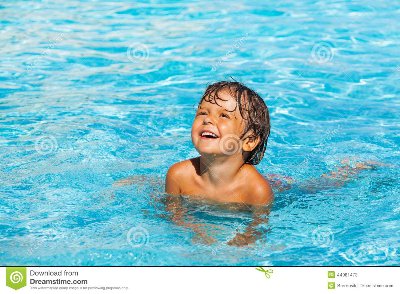 Laughing Boy Plays And Splashes Water Around Him Stock