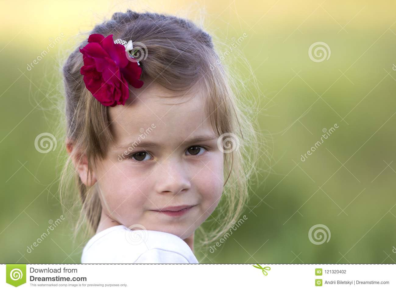 Portrait of beautiful small preschool blond girl with nice gray