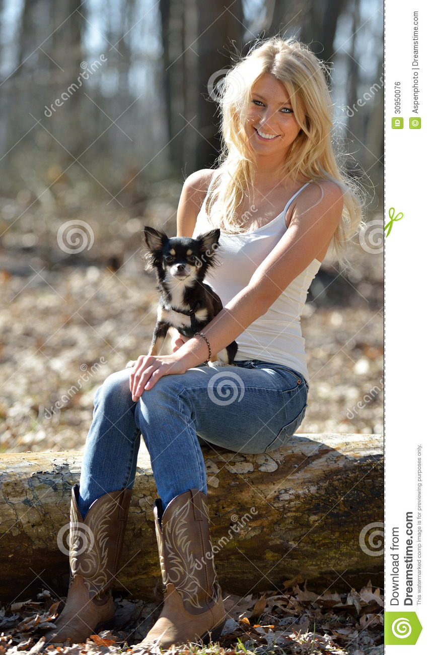 Portrait Of A Beautiful Smiling Blonde Woman And Her Small