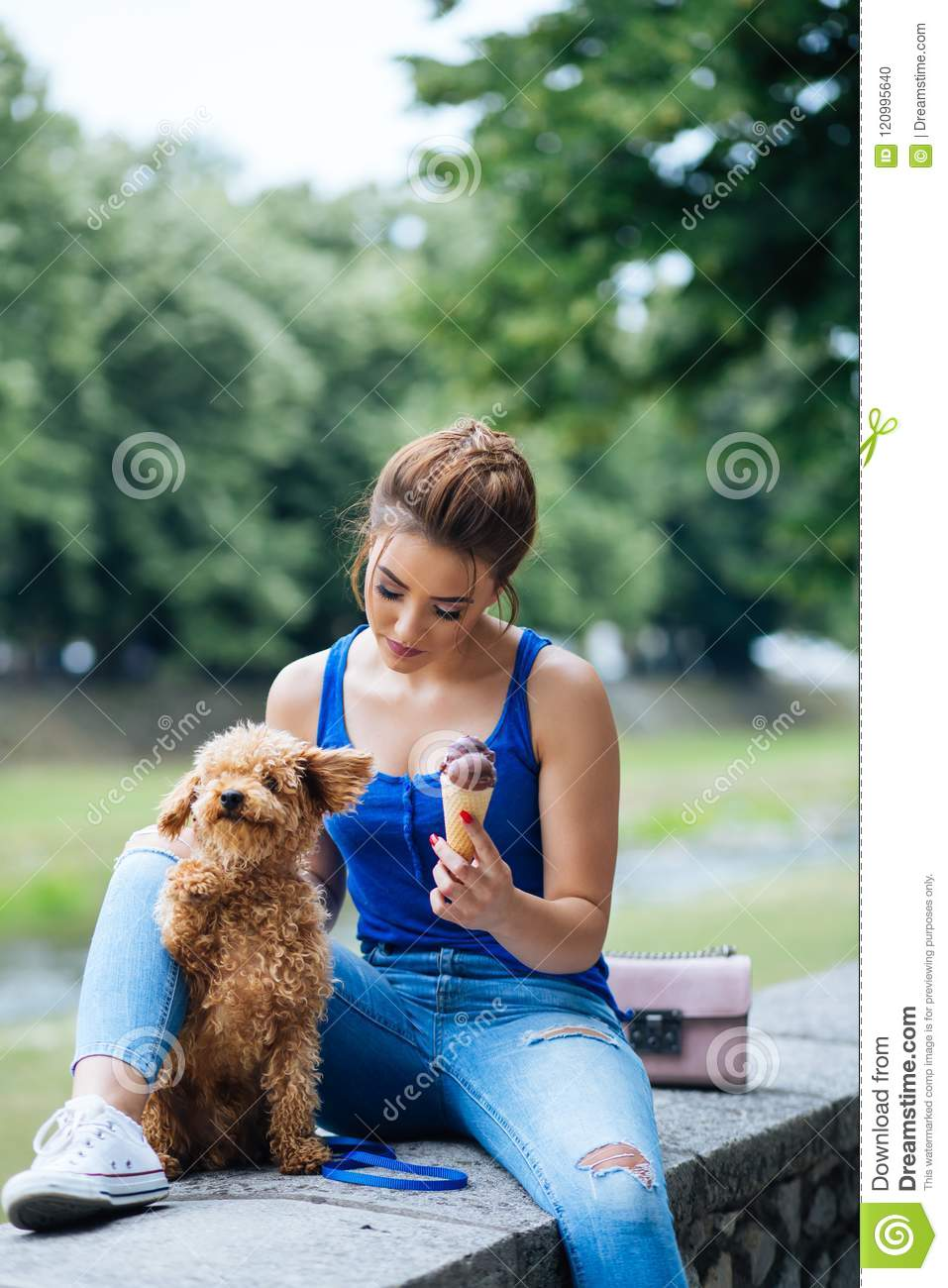 Teenager girl with red poodle