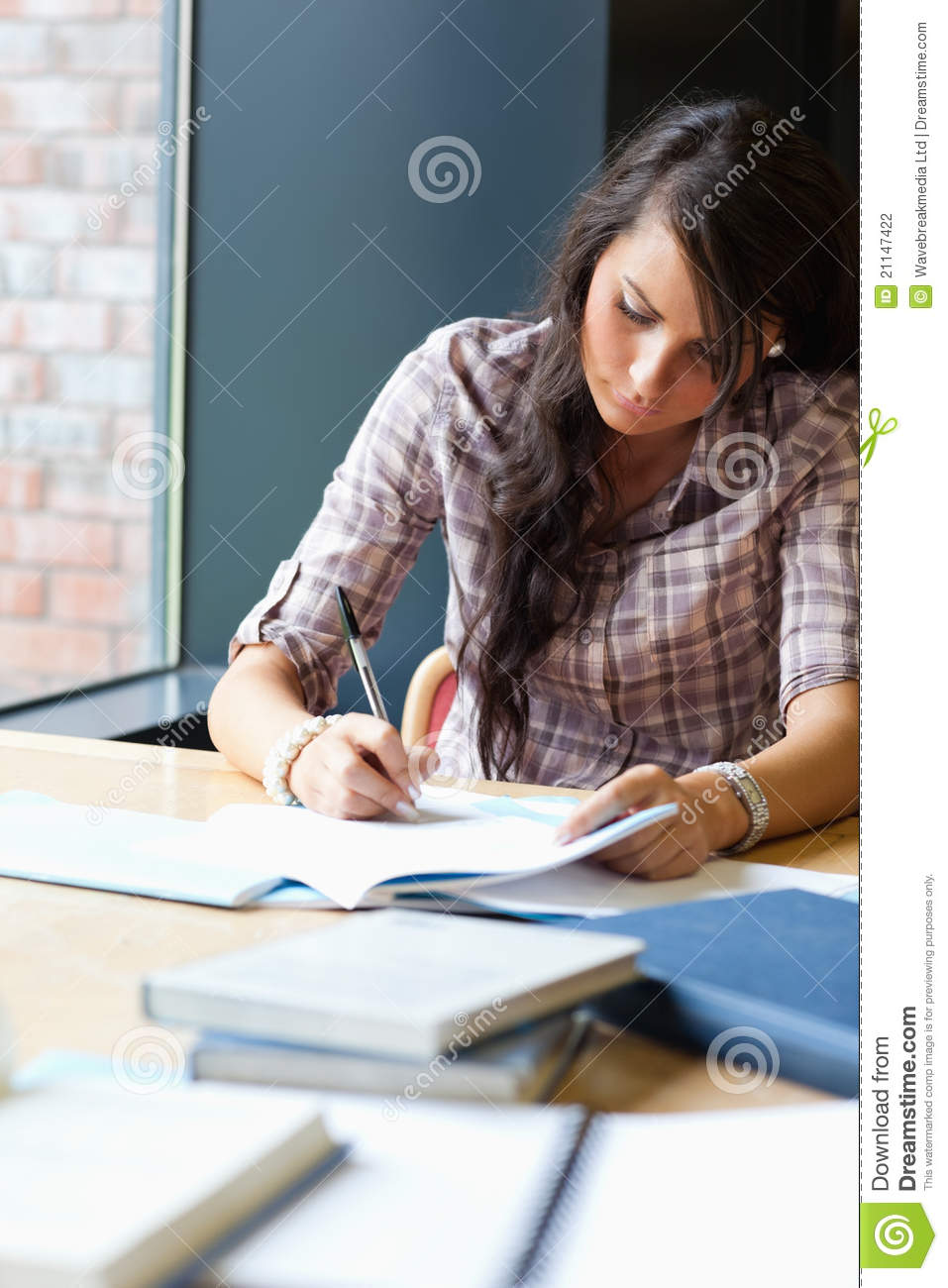 portrait of a beautiful student writing an essay stock photography royalty stock photo