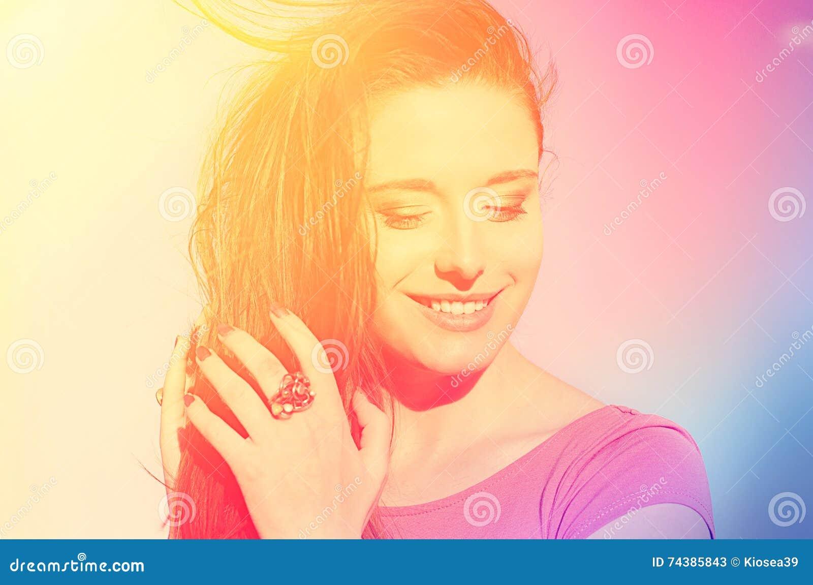 Portrait beautiful sunshine girl. Closeup happy smiling woman on summer day