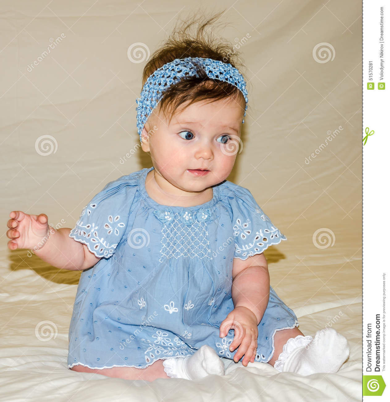 Portrait Of The Beautiful Sweet Little Baby Girl In A Blue