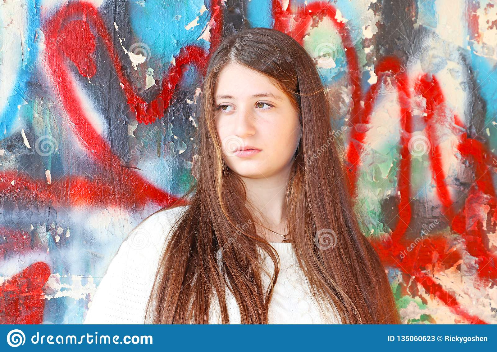 Portrait of a beautiful teenage girl with long hair