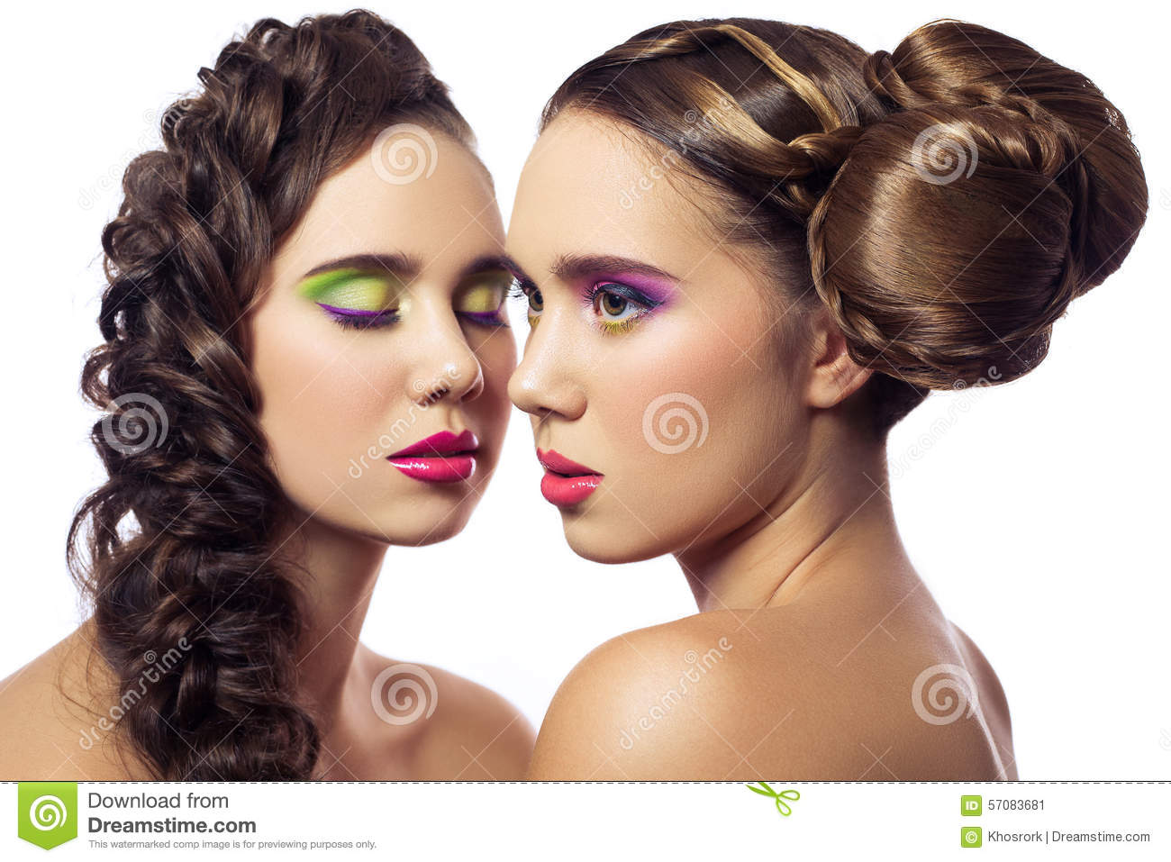 Portrait of beautiful twins young fashion women with hairstyle and red pink green makeup. isolated on white background.